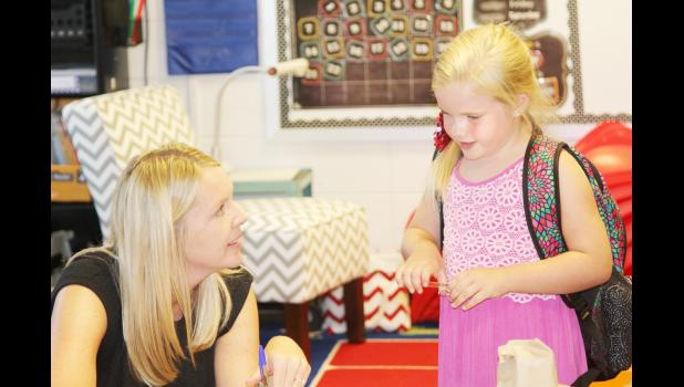 Kindergarten teacher Kay Goshorn greets Brie Nelson at the open house and back to school night Monday evening.  (Photo by Kim Wegener)