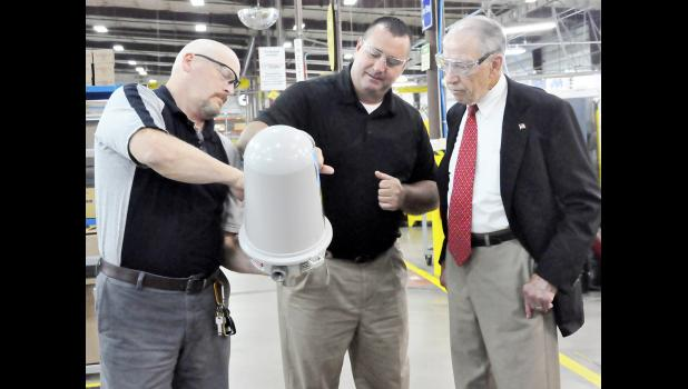 Senator Chuck Grassley talks with employees.