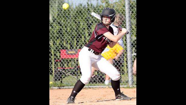 Spartan senior Grace Greving takes a pitch high. (Photos by Mike Oeffner)