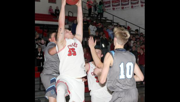 HCHS senior Jacob Hansen (55) pulls down one of his 10 rebounds in Friday's 52-49 Cyclone win over Lewis Central. (Photo by Kim Wegener)