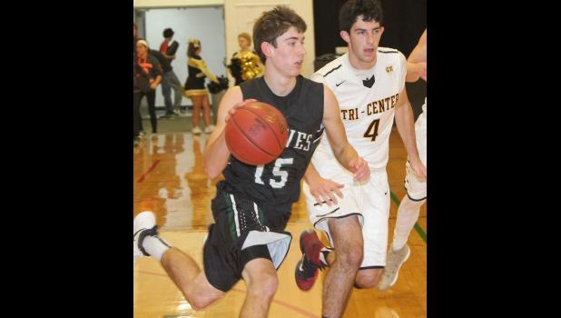 Wolves senior Jared Johnson pushes the ball up the floor. (Photos by Kim Wegener)