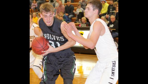 IKM-Manning junior Alex Lingle (left) drives into the lane against Tri-Center on Tuesday night.