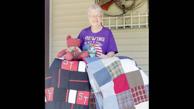 Marsha Hursey made a quilt (on the right) following the death of her son, Wade, from some of his clothing as a memory keepsake.  Also shown is a quilt made from old Shelby-Tennant band uniforms.