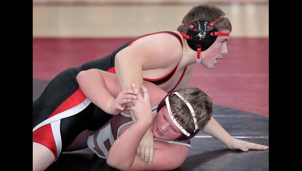 MATCH OF THE NIGHT -- The most exciting match of Thursday's double dual in Harlan was the junior varsity contest at 195 pounds between Cyclone freshman Tyler Mumm and his counterpart from Shenandoah. Mumm (on top) rallied in the third period before falling short 6-5.