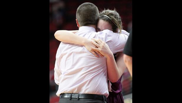 Sophia Peppers embraces head coach Tom Petersen near the conclusion of Friday's game. (Photos by Mike Oeffner)