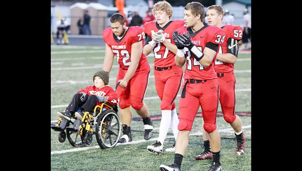 Pictured with Jaxon Rold are players Ethan Leinen, Wyatt Schaben, Jonathan Owens and Caleb Bieker.  Rold is battling a rare and aggressive form of brain cancer.