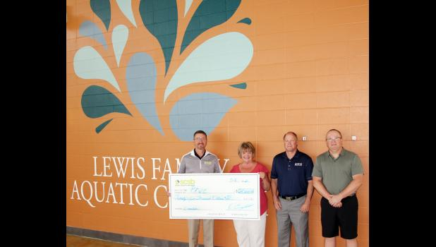 """HARLAN -- Shelby County State Bank donated $25,000 to the """"Make a Splash"""" fundraising campaign. Shown are L to R -- Kevin Campbell -  Shelby County State Bank President and CEO; Jan Norgaard - Shelby County Health Foundation President ; Barry Jacobsen - Myrtue Medical Center's CEO ; and Todd Alberti - Petersen Family Wellness Center Director."""