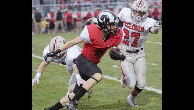 HCHS linebacker Wyatt Schaben (27) and cornerback Tanner Fink chase down Ram receiver Lance Hughes.