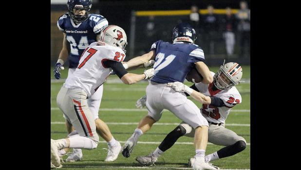 HCHS seniors Thomas Fah (right) and Wyatt Schaben combine to tackle LC's Dane Norville.