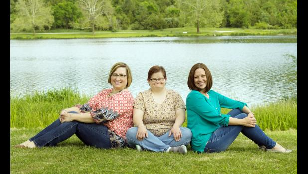 Erin Berkley (center) with sisters Jennifer (left) and Lee.