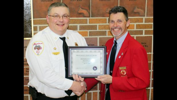 Chief Bissen received a Meritorious Service Award for 30 years of Service from Past President Mark McNees of the Iowa Firefighters Association.