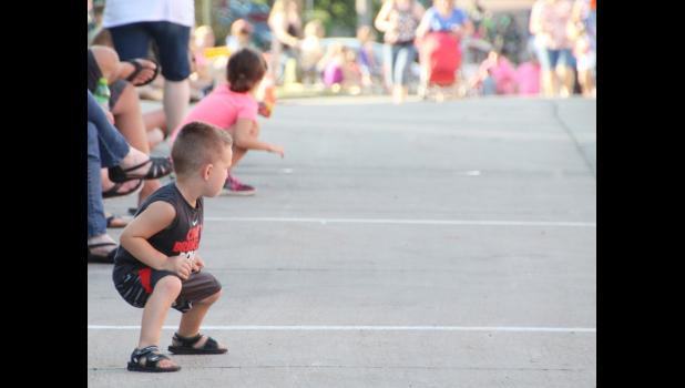 A child waits for candy to be thrown at the Shelby County Fair parade