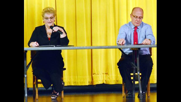 Shelby County Auditor Marsha Carter makes her opening statement as challenger Mark Maxwell looks at his notes before also making a statement.  Approximately 50 people turned out for the candidates' forum Tuesday, Oct. 11 where the two discussed the issues.