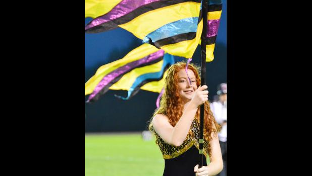Grace Greving spinning the flags during halftime.