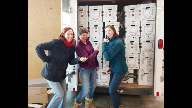 Loading up a truck are L to R -- Jen Ben, Amber Mohr and Ellen Walsh-Rosmann.