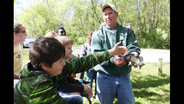 Justin Brus, IKM-Manning sixth grader, feels the teeth of a fish during a demonstration by the Iowa DNR's Brian Hayes. See more photos in Tuesday's Harlan Tribune.  (Photo by Sarah Muller)