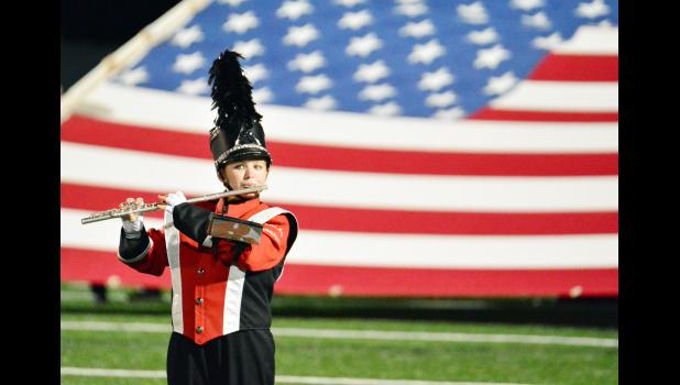 Nothing portrays a slice of Americana more than football Friday nights, marching bands and the American flag.  Here, Hailey Schumacher plays in the HCHS band last Friday night at Merrill Field.