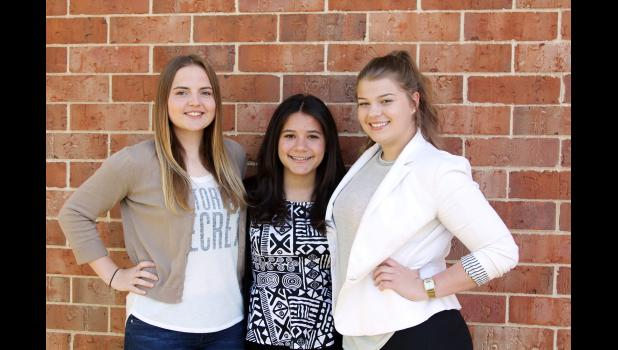"""From left: Leonie Finkbeiner, Alfonsina """"Bonlli"""" de Santos Guzman and Anja Steiger have spent the past school year at HCHS as foreign exchange students. They will all be returning to their home countries soon. (Photo by Kim Wegener)"""