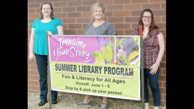 Staff at the Harlan Community Library have been planning fun and challenging activities for youth and adults this summer. From left: Elizabeth Schechinger, Amanda Brewer, library director; and Dena Jacobsen.