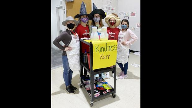 Manning the Kindness Cart at the Harlan Elementary Schools recently were L to R -- Josie Sonderman, Adelyn Berndt, Aubrey Petsche, Mia Schweiso, and Aubry Christensen.  The club is promoting kindness in the schools, and is taking its efforts outside the school building this spring as well.
