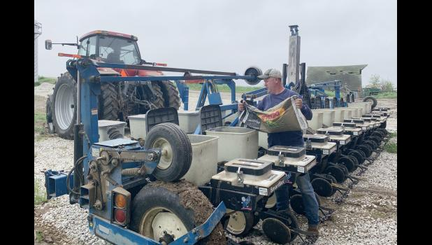 Doug Kramer, Earling, fills the planter during planting season this year.  A dry planting season with timely May rains and crops are ready to take off.
