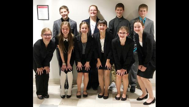The eighth grade team includes front L to R -- Gabby Gaul, Macy Reischl, Madison Kjergaard, Vanessa Sotelo, Ava Miller and Ellie Ineson.  Back L to R -- Kaiden Milliken, Madison Pope, Steven Leinen and Brad Curren.