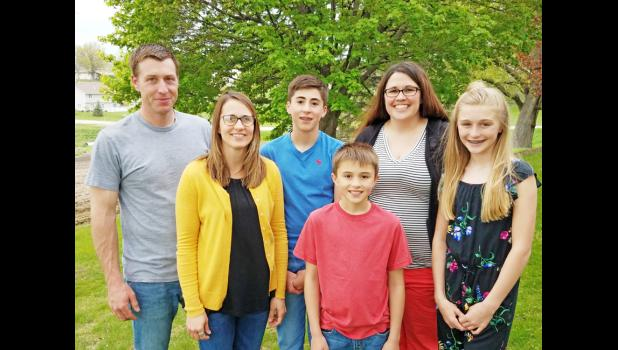 HARLAN -- Lindsey Vorm poses for a photo with her sister Andrea's family. Front row left to right: Andrea, Kye and Mari Gleason Back Row, left to right: Dustin and Grant Gleason and Lindsey Vorm.