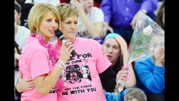 Nancy Osborn and Lori Baughman share an embrace after Baughman was honored as a Cancer survivor.