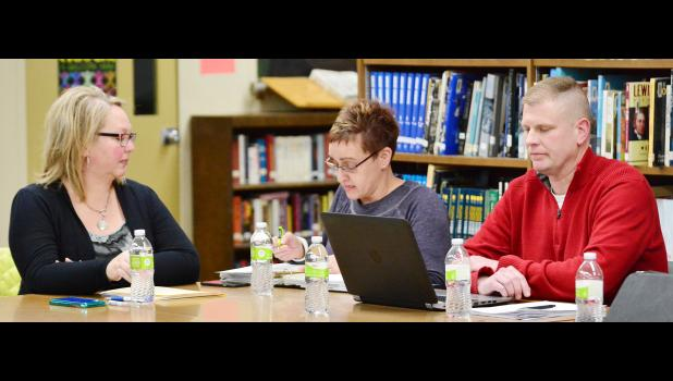 HCS Board President Amy Rueschenberg reads a statement from the district's attorneys answering questions from Harlan citizen Larry Trickel, while board vice-president Jessica Anderson and HCS Superintendent of Schools Justin Wagner listen.  The board won't address Trickel again after months of his accusations, allegations, suggestions and insinuations about the board, board leadership and Wagner investigation.