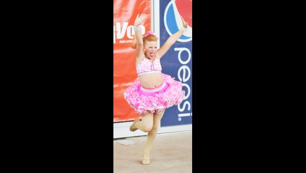 Taryn Schuning, 10, Portsmouth, performs a musical theater solo on August 12.