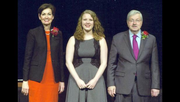 Harlan Community High School's Rebecca Sparandeo was honored as a governor's scholar by Iowa Gov. Terry Branstad (right) and Lt. Gov. Kim Reynolds (left).  (Photo contributed)