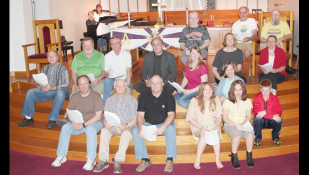 Cast members who will present May Day Melodies Sunday in Elk Horn include front L to R -- Tony Buman, Keith Bauer, Dallas McDermott, Maggie Buman, Katie Burchett and Sam Buman.  Second row L to R -- Clarence Coenen, Clark Ahrenholtz, Seth Johannsen, Pastor Keith Menter, Rya Eck, Lee Burchett, Deb Miller and Pat Crosley.  Back L to R -- Sharon Davidson and Kay Johannsen (by piano), Sharon Donlin, Tom Potts and Terry Crosley.