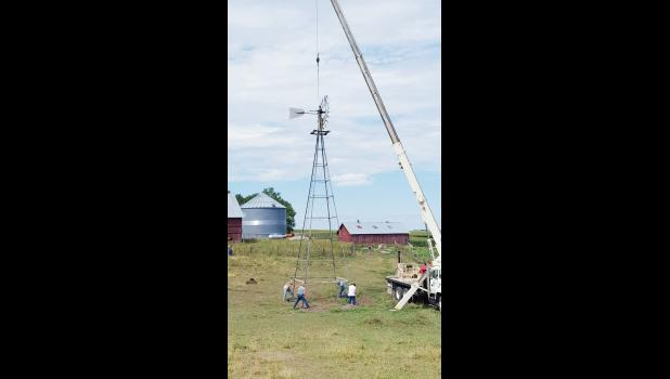 The restored windmill gets erected in place on the Earling farm.