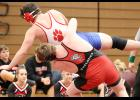 HCHS 220-pounder Joey Arkfeld sends Abraham Lincoln's Ben Price for a ride en route to a 6-4 victory on Tuesday night.