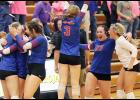AHSTW players celebrate following Tuesday's four-set regional win at Tri-Center. The Lady Vikes defeated the Trojans for the first time since 2001. Left-right: Kailey Jones, Claire Harris (3), Kinsey Scheffler (23) and Paige Osweiler. (Photos by Mike Oeffner)