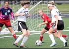 HCHS sophomore Lucy Borkowski (14) and freshman Hannah Bissen (24) converge on the ball in front of a Creston defender and goalie during Friday's match at Merrill Field. The Cyclones came up empty on this scoring chance but beat the Panthers 5-1.