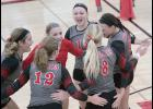 Cyclone players celebrate a point during Thursday's regional sweep of Dallas Center-Grimes. Left-right: Taylor Frederick, Jess DuVal (12), Jordyn Moser, Haley Arkfeld (13), Lexie Holloway (8) and Haley Leinen. (Photos by Mike Oeffner)