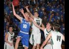 Remsen St. Mary's sophomore Spencer Schorg (10) gets past IKM-Manning defenders Austin Lingle (30), Ethan Carter and Jared Johnson (14) as Austin Ahrenholtz looks on. (Photos by Kim Wegener)