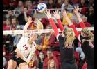 Iowa State junior Jess Schaben (14) goes on the attack against Texas Tech's Katy Keenan and Missy Owens during the Cyclones' 3-0 sweep of the Red Raiders on Saturday at Hilton Coliseum. Schaben had eight kills while adding a career-high 23 digs.