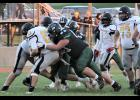 IKM-Manning's Max Nielsen (63) leads the defensive charge in tackling Tri-Center's Jaxyn Valadez during Friday's first half. The Wolves beat the Trojans 16-6. (Photo courtesy of Brandi Perdew)