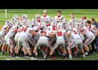 Harlan Community players get fired up prior to Friday night's kickoff against the Atlantic Trojans.