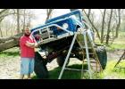 Shown is Burchett with his customized vehicle he is driving on the show.