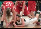 IKM-Manning's Kia Rasmussen dives for a loose ball as Treynor's Madelyn Deitchler (45) and Kayla Chapman battle for Treynor during Friday's WIC contest. (Photos by Mike Oeffner)