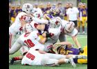 A Denison-Schleswig ball carrier is swarmed by a host of HCHS tacklers, including Alex Schechinger (42), Allen Fries (17), Isaiah Ahrenholtz (18), Chandler Leinen (54), Will McLaughlin (right) and Eli Monson (9).