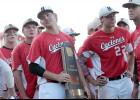 Harlan Community senior Joshua Cheek holds the Cyclones' Class 3-A state runner-up trophy following Saturday's 10-1 loss to Davenport Assumption in the championship game at Principal Park. HCHS finished the season with a 36-3 overall record, breaking the previous school record of 32 wins set in 1996.