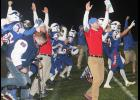 AHSTW head coach Davis Pattee celebrates Brayton Tuma's game-winning PAT catch with his players at the conclusion of Friday's 30-28 three-overtime win vs. Alta-Aurelia.