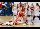 AHSTW's Julia Kock (left) and Treynor's Mandy Stogdill crash hard to the floor following a loose ball scramble. Also pictured for the Lady Vikes are Claire Harris (13), Claire Denning, Morgan Heiny and Kailey Jones (2). AHSTW built a big first-half lead and held off the Cardinals 48-39. (Photos by Bob Bjoin)