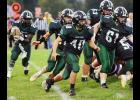 IKM-Manning senior Amos Rasmussen carries the football against Logan-Magnolia behind a convoy of blockers, including Taylor Williams (61), Max Nielsen (63), Trey Jasa (40) and quarterback Nolan Ramsey (17). Rasmussen rushed for 127 yards on 29 carries but the Wolves were defeated 29-19 by the sixth-ranked Panthers. (Photos by Bob Bjoin)