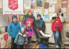 Anyone who can help with local bell ringing for The Salvation Army can contact Pastor Donna Ewert, Shelby County Community Outreach or West Central Community Action.  Above, Levi, Logan, Lauren and Lance Obrecht, children of Jill and Steve Obrecht, joined Janet Carbonell and Marian Greer-Stokes (right) with Salvation Army bell-ringing and Christmas carols.