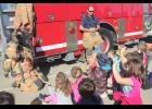 Kristi Pederson with the Harlan Volunteer Fire Department speaks about fire safety to students in Mrs. Andersen's kindergarten class at the Harlan Community Primary School on Monday, Oct. 7. (Photo by Kim Wegener)